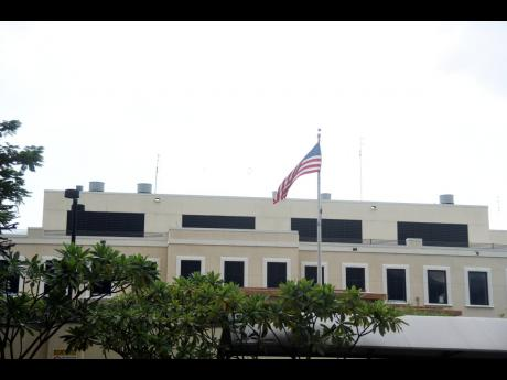 The American flag flies at the United States Embassy on Old Hope Road, St Andrew, on Sunday. The embassy has declined to comment on accusations of a cover-up by former ambassador Donald Tapia.