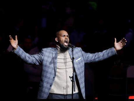R Kelly performs the national anthem before an NBA basketball game between the Brooklyn Nets and the Atlanta Hawks in New York on December 21, 2007.