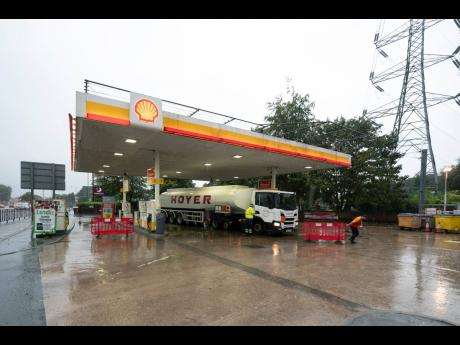 A fuel delivery is made to a petrol station in Manchester, England, which had run out of fuel after an outbreak of panic buying in Britain over the past several days. AP Photo