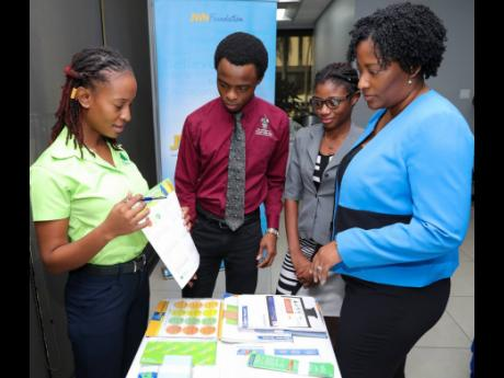 CEO of the JWN Foundation (JWNF), Tanikie McClarthy Allen (left), shares career advancement advice during a development workshop with JWNF tertiary scholars.