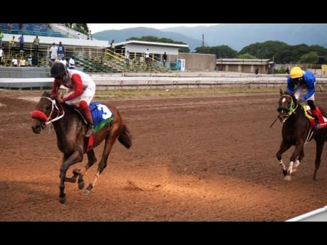Samantha Fletcher (left) rode HONEY BUNCH to victory in the 11th race at Caymanas Park on yesterday. It was her third win on the 11-race card.