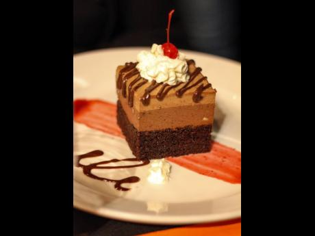 With the fudge chocolate cake, topped with milk and dark chocolate mousse, it's no wonder it is called Death by Chocolate.