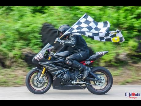 It takes a lot of guts to get a checkered flag on a bike at Dover.