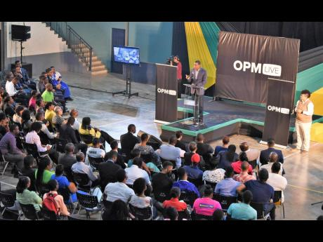 In this 2017 file photo, Prime Minister Andrew Holness addresses persons attending 'OPM-Live' mini town hall meeting at Jamaica College in St Andrew. The debate around NIDS, which included issues such as biometrics, data security and privacy, was fund