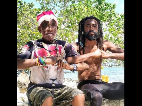 Dub creative Everaldo 'Evie Pukupoo' Creary (right) and reggae icon Lee 'Scratch' Perry.