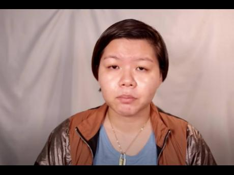 Elaine Lim in a screen grab from the video she posted to YouTube.