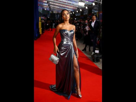 'Two Distant Strangers' star Zaria Simone stuns in a metalic gown and matching accessories.