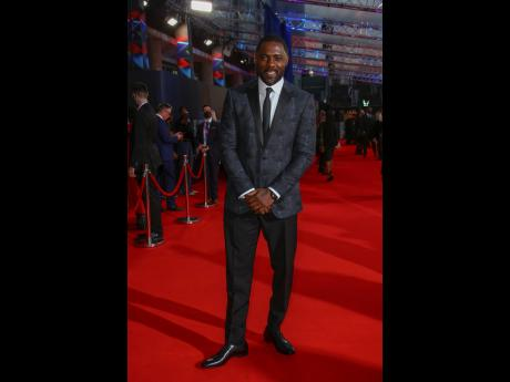 right: Idris Elba ditched his holster and duster for a suit on the London Film Festival red carpet.