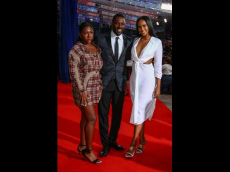 FAMILY MAN: Idris Elba, daughter Isan Elba (left), and wife Sabrina Dhowre Elba pose for photographers upon arrival at the opening of the London Film Festival.