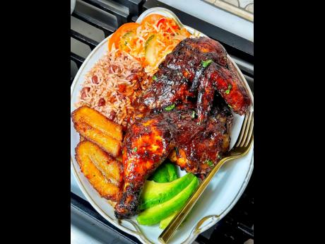 Oven-roasted chicken served with traditional rice and peas and fried plantains.