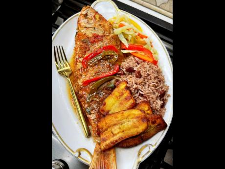 The brown stewed red snapper is ready and waiting to be savoured.
