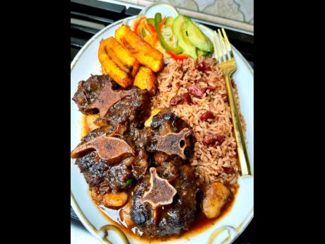 Oxtail lovers will enjoy this tasty meal, accompanied by a filling dose of beans and 'spinnas'.