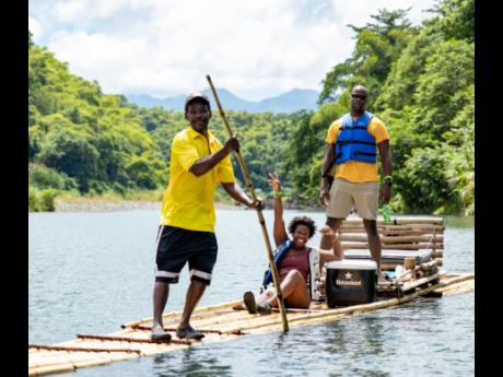 Brother and sister duo Teika and Roberto Samuda of Being Jamaican Tour Company are happily rafted down the Rio Grande by Raft Captain Lawrence Chisolm.