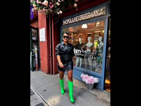 Above: Glam Expressway owner Lindsay Stuart in a vegan leather dress available at her store.