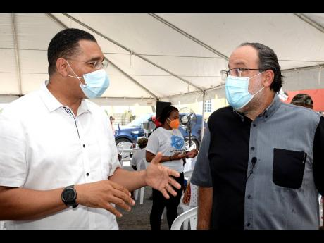Can you imagine how Jamaicans would have responded if Andrew Holness and Mark Golding were to appear simultaneously in an advertisement, promoting immunisation among the citizens?