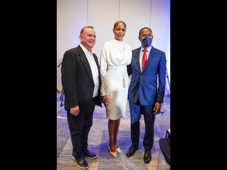 From left: Francisco Angulo of Realogy; Julian Dixon, co-owner of Sotheby's International Realty Jamaica; and Dr Nigel Clarke, minister of finance and the public service, pause their conversation for a quick photo op.