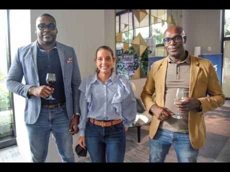 Gregory Samuels (left), executive director and head of corporate advisory, Sygnus Capital; Elizabeth James (centre), head of wealth management,  and Berisford Grey, co-founder and CEO, enjoy being 'outside' at the recent launch of Sotheby's Internati