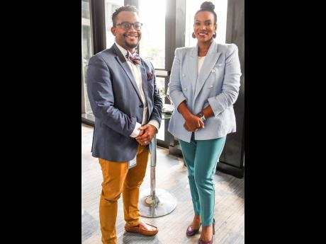 Sean Taylor, head of digital marketing, Barita Investment Ltd, and Terise Kettle, vice-president of investment banking, make a statement at the launch of Sotheby's International Realty at the AC Hotel last Friday.