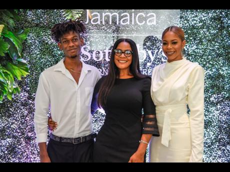 A Family Affair: Julian Dixon (right), co-owner of Sotheby's International Realty Jamaica, shares lens time with her mother Paulette Wildman and brother Leonardo Wildman.