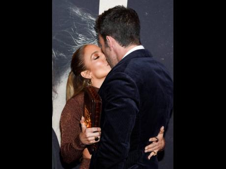 That's Amore! Actor Ben Affleck and girlfriend entertainer Jennifer Lopez kiss at the première of 'The Last Duel' at the Rose Theater at Jazz at Lincoln Center on Saturday.