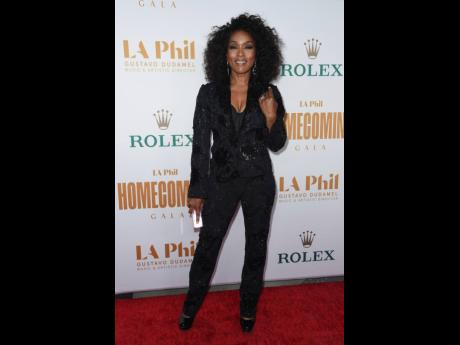 Angela Bassett arrives at the Los Angeles Philharmonic Homecoming Concert & Gala on Saturday wearing a black embellished pantsuit.