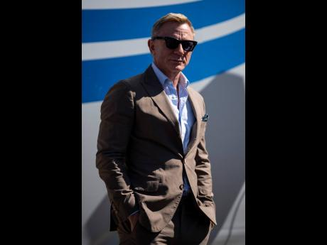 Actor and honorary starter Daniel Craig poses in Victory Lane prior to a NASCAR Cup Series auto racing event at Charlotte Motor Speedway on Sunday in Concord, North Carolina.