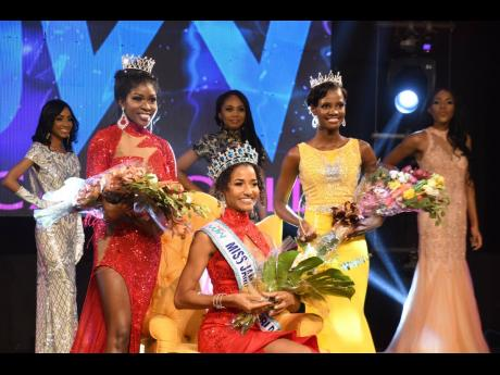 Miss Jamaica World 2021 Khalia Hall (centre), is flanked by Dominique Shorter (left), first runner-up in the Miss Jamaica World pageant, and actress Melessa Vassell, second runner-up.