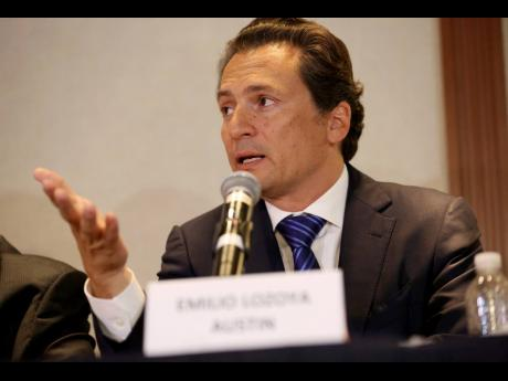 In this August 17, 2017 photo, Emilio Lozoya, former head of Mexico's state-owned oil company Pemex, gives a news conference in Mexico City.