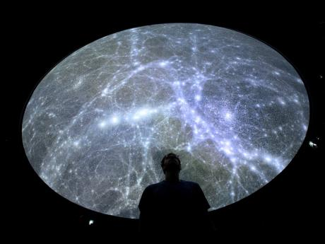 Hadrien Gurnel, software engineer at EPFL's Laboratory for Experimental Museology (eM+), explores the most detailed 3D map of the universe with the virtual reality software VIRUP, or Virtual Reality Universe Project, in St-Sulpice, near Lausanne, Switzer
