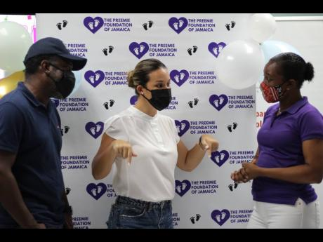 Entertainers Wayne Marshall (left), and Tami Chin Mitchell are engrossed in a conversation with Serika Sterling (right), founder of the Preemie Foundation of Jamaica.