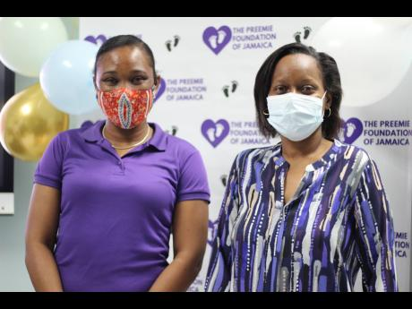 Founder of the Preemie Foundation of Jamaica Serika Sterling (left), shares a frame with Dr Blondell Crosdale during a treat for the staff of the Neonatal Intensive Care Unit at the University Hospital of the West Indies.