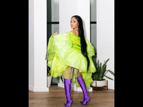 Yawdie Babe for sure! Dancehall artiste Shenseea makes a statement in purple thigh highs and a bedazzled body suit.