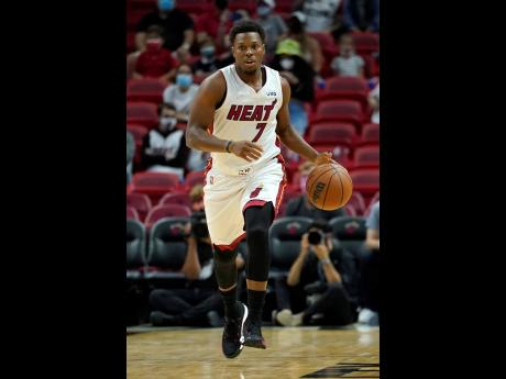 Miami Heat guard Kyle Lowry in action during the first half of a preseason NBA basketball game against the Charlotte Hornets, Monday, October 11, 2021, in Miami.