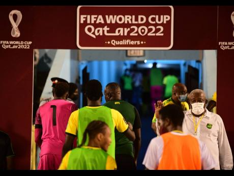 Head coach Theodore Whitmore (centre background) exits the field and heads down the tunnel at the National Stadium following the 0-0 finish in the Jamaica vs Canada  World Cup qualifier on Sunday, October 10, 2021.