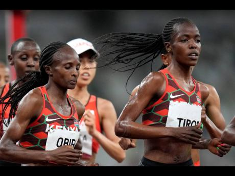 Kenya's Hellen Obiri (centre) and Agnes Tirop (right) compete in the women's 5000m final at the 2020 Summer Olympics in Tokyo, Japan. Tirop, a two-time World Athletics Championships bronze medallist, was found dead at her home in Iten in western Kenya, the