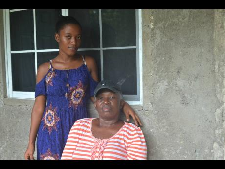 Maxine Moulton-Drummond (seated)and her daughter, Rennecia Reid, at their home in Retrieve, St James. Moulton-Drummond, who is currently undergoing cancer treatment, had a mastectomy to remove her left breast in 2015.