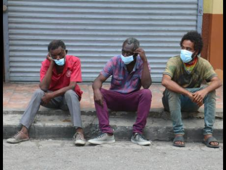 Some homeless and mentally ill persons waiting on their vaccine at the St James Parish Council Care Centre in Montego Bay on Sunday.