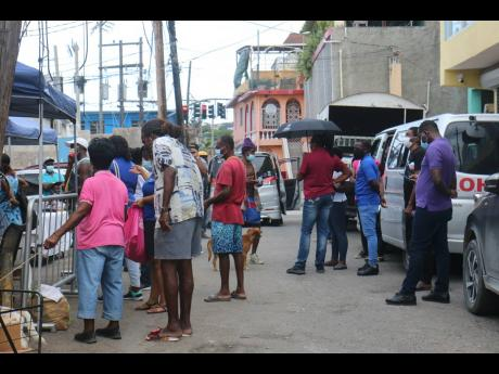 Scores of mentally ill and street persons show up to take their vaccine on World Mental Health Day on Sunday at the St James Parish Council Care Centre in Montego Bay.