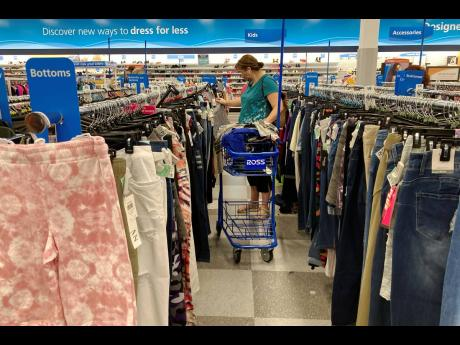 In this July 21, 2021 photo, a consumer shops at a retail store in Morton Grove, Illinois.