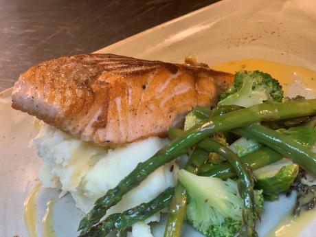 Honey and lemon brush seared salmon fillet dill beurre blanc, topped with toasted almonds and lemon.