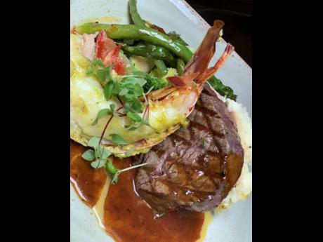 Classic Caribbean surf and turf Dijon and herb crusted beef tenderloin and pimento grilled lobster tail, served in a red wine reduction and garlic butter sauce.