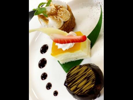 The pastry chef's anniversary dessert tasting — zesty mini lemon meringue pie, Blue Mountain Coffee cream profiterole and bitter chocolate whiskey sauce white chocolate cheesecake with mango and wild thyme.