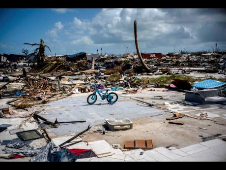 An abandoned bicycle stands in a space that used to be a house, in a neighbourhood destroyed by Hurricane Dorian, in Abaco, Bahamas. Dorian hit the northern Bahamas on September 1, 2019 with sustained winds of 185 mph (295 kph), unleashing flooding that re