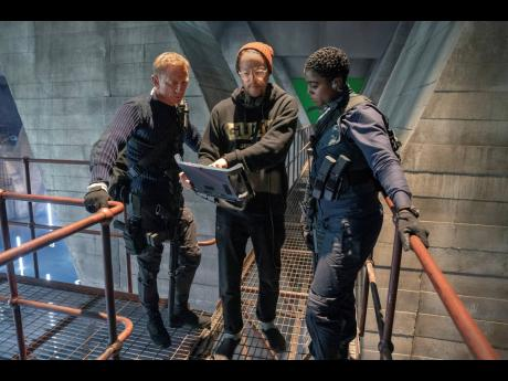 Director Cary Joji Fukunaga (centre), with actors Daniel Craig (left), and Lashana Lynch on the set of the James Bond film 'No Time to Die'.