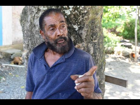 Claude Dunn, a resident of Stony Gut in St Thomas, is disappointed that more has not been done to develop national hero Paul Bogle's former village.