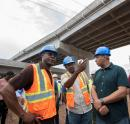 Prime Minister Andrew Holness in dialogue with E.G. Hunter (left), chief executive officer of the National Works Agency, and Varden Downer (centre), acting deputy director of project implementation, at the overhead bridge in Three Miles, one of five locations visited by the prime minister yesterday.