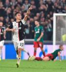 Juventus' Paulo Dybala celebrates after scoring a goal during the UEFA Champions League Group D match against Lokomotiv Moscow at the Allianz Stadium in Turin, Italy, yesterday. Juventus won 2-1.