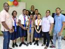 Members of the winning Oracabessa Primary School ACE Quiz Bowl team with Gregory Davis (left), principal; Winston Moncrieffe (centre), quizmaster; Althia Duckie-Foster (second right), general manager, Galina Breeze Hotel; and team coach, Cleon Willis (right).