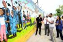 Looking at the mural from left are Clement 'Jimmy' Lawrence, chairman of J. Wray and Nephew; Anthony Hylton, MP; Greg Bailey, artist in charge of mural painting and design; and Miriam Hinds-Smith, dean of the School of the Visual Arts, Edna Manley Coll