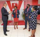 Scotiabank's Perrin Gayle (left), senior vice-president, retail banking, and Yvett Anderson, district vice-president, are snapped in conversation with Sheryl Anderson (second left), chief executive officer of QSSI Ltd, a former participant in the Scotiab